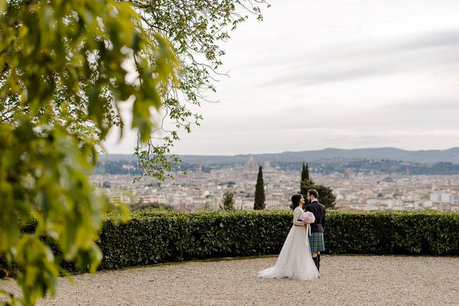 wedding couple embracing with Florence backdrop