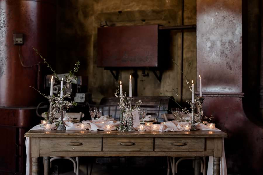 industrial chic wedding style in tuscany dinner table setting