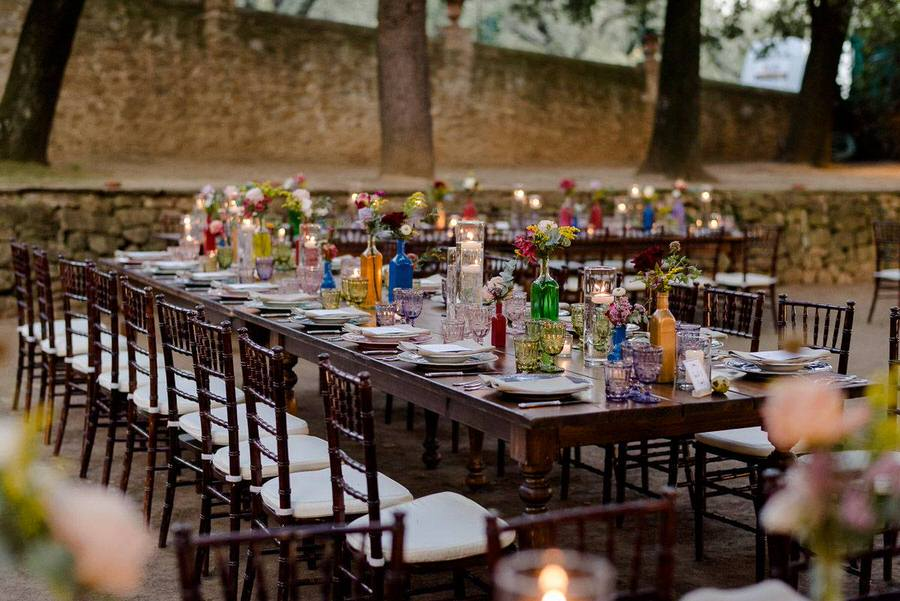 colourful tables in a wedding in a garden in tuscany