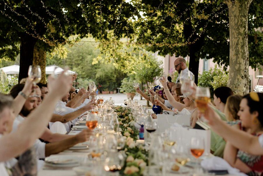 toast at wedding dinner in tuscany