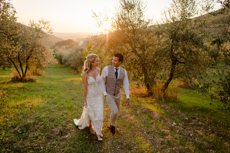 A romantic couple walking at Borgo i Vicelli Florence