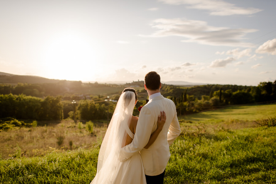 romantic wedding couple looking the landscape at Borgo Stomennano, Monteriggioni, Siena