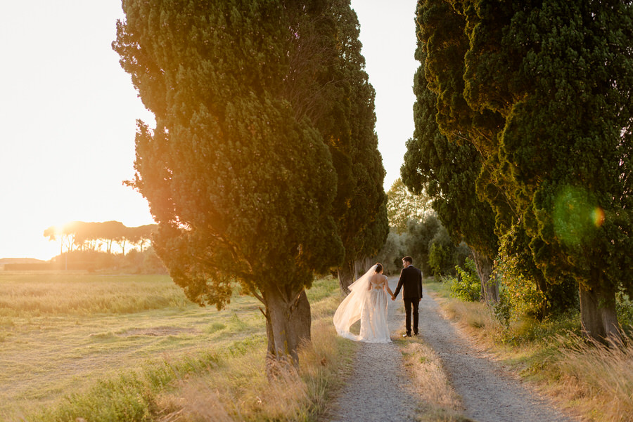 A romantic couple walking during the golden hour at Villa Ravano, San Giuliano Terme, Pisa