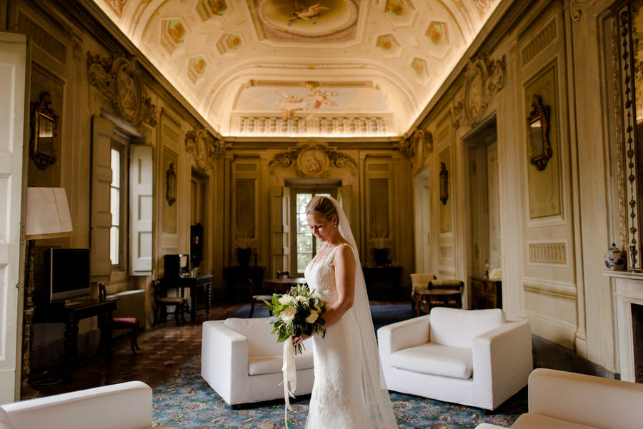 bride dressing her wedding dress in a castle in tuscany