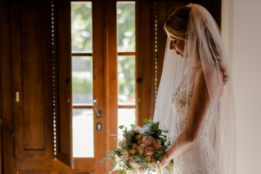 bride with her wedding dress just before the ceremony in tuscany
