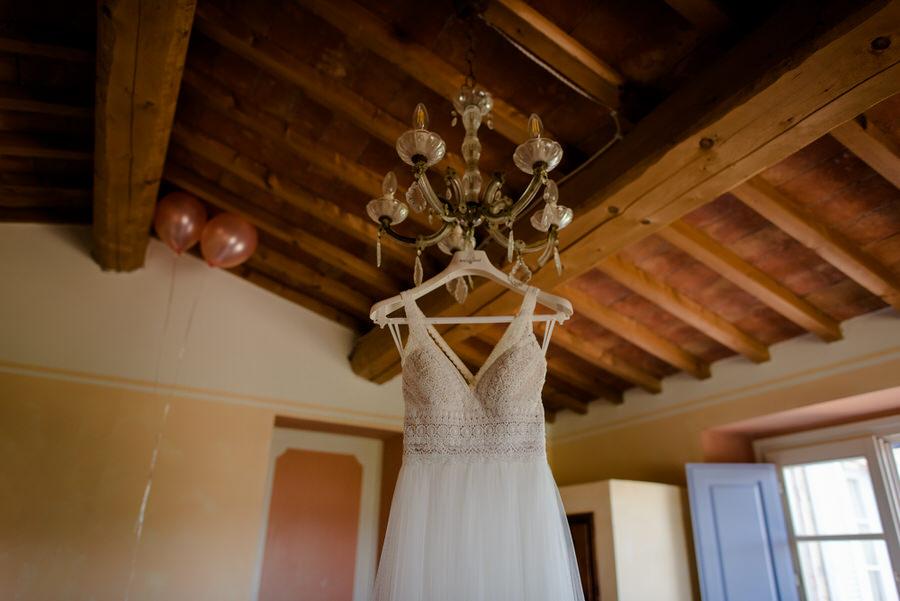 wedding dress hanged on the lamp