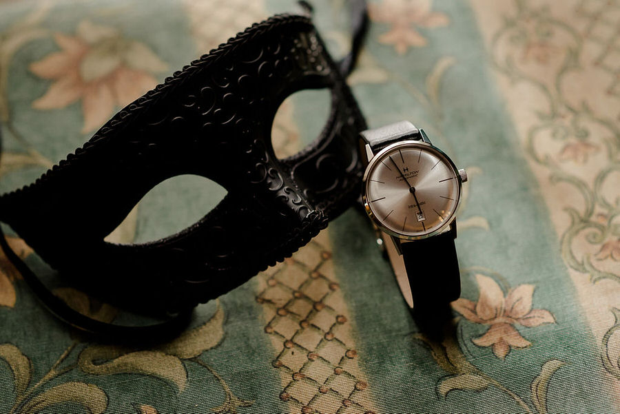 black mask and watch for groom