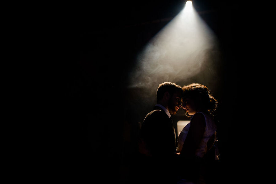 light spot on a wedding couple in a theather